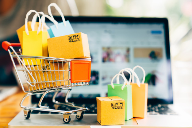 product-package-boxes-shopping-bag-cart-with-laptop-online-shopping